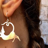 dancing queen earrings, saw pierced silver