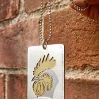 zodiac tag, saw pierced brushed silver, brass and titanium, stainless