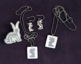 boom boom bunny brooch earrings and tags, saw pierced brushed silver and titanium, stainless